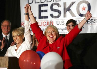 Republican U.S. Congressional candidate Debbie Lesko, right, celebrates her  win with former Arizona Gov. Jan Brewer at her home, Tuesday, April 24,  2018, ...